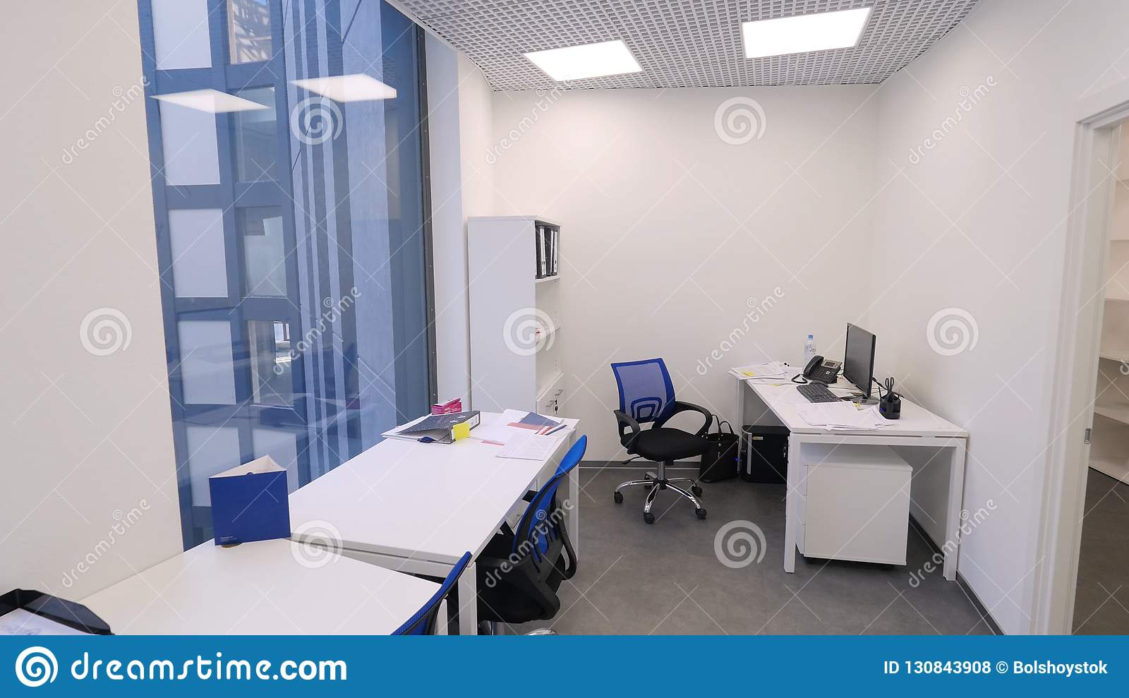 Small Office View Non Working Time In Office Modern Compact Office Room With Several Workstations And Bright Stock Photo Image Of Concept Glass 130843908