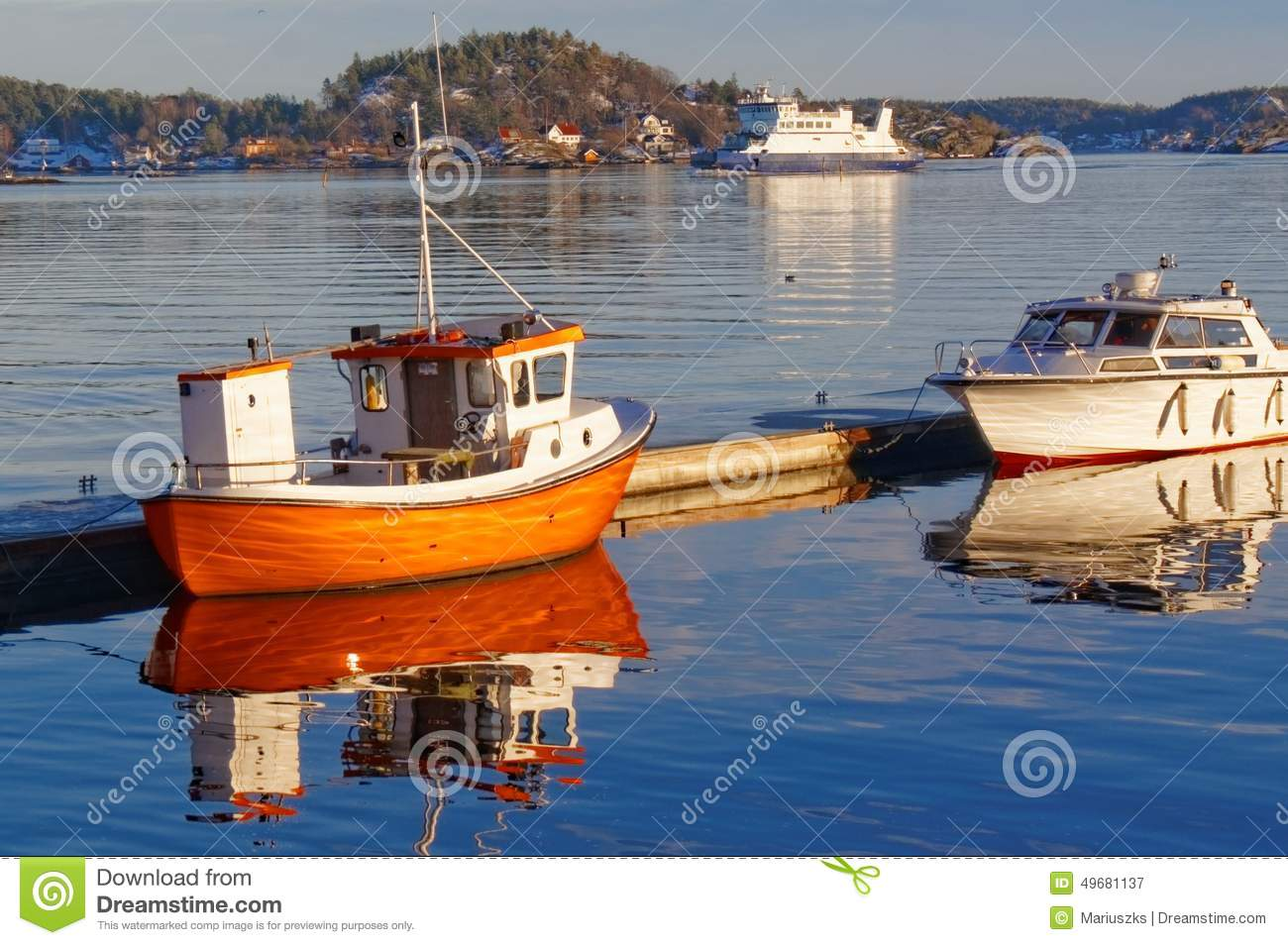 Small Orange Fishing Boat With Reflection In The Water Stock Photo - Image: 49681137