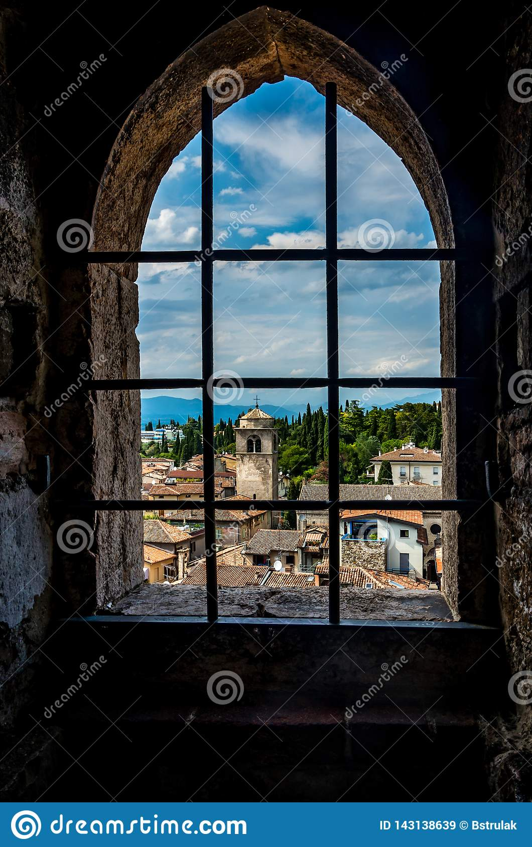 The small picturesque town Sirmione by the Lake Garda in Italy framed in a window