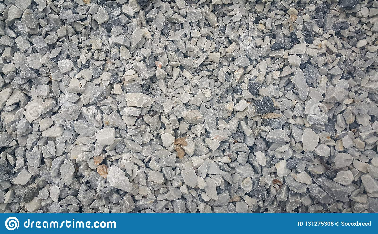 Small piles of limestone for use in lime kiln line .