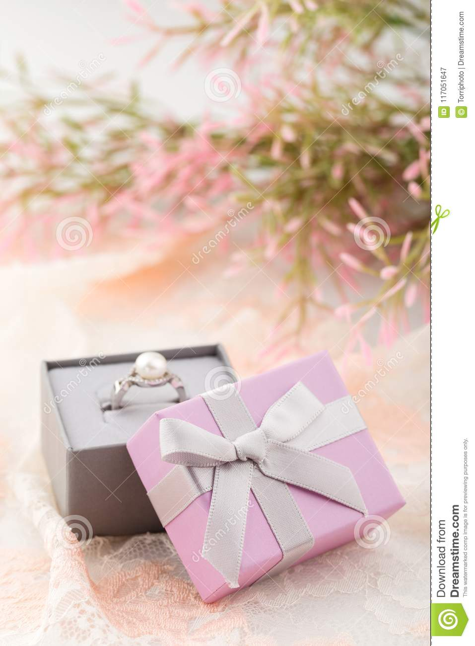 Small Pink Jewelry Gift Boxes With Bow On Lace Background Stock