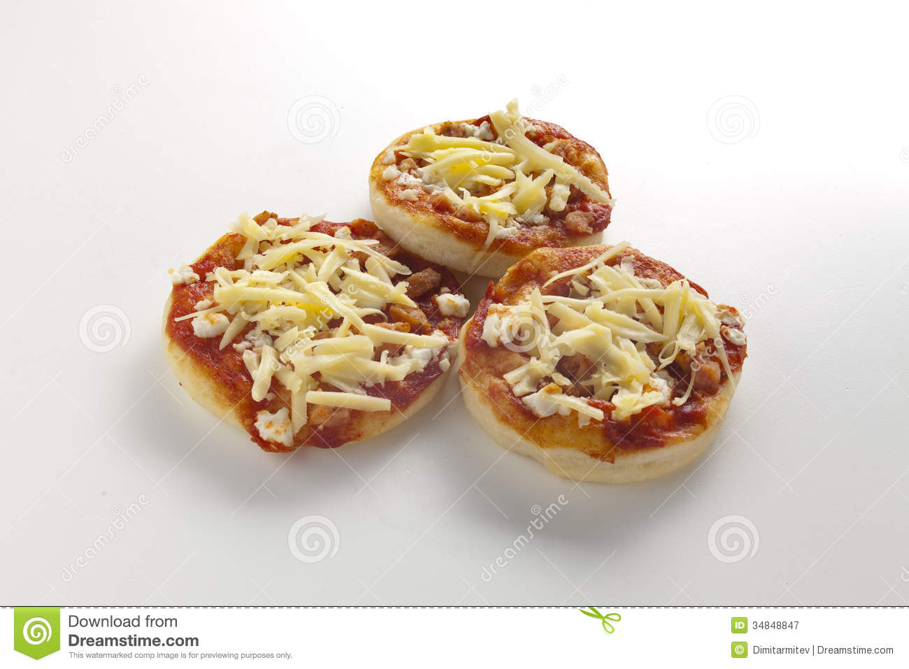small pizza with cheese and tomato three small pizzas on white ...