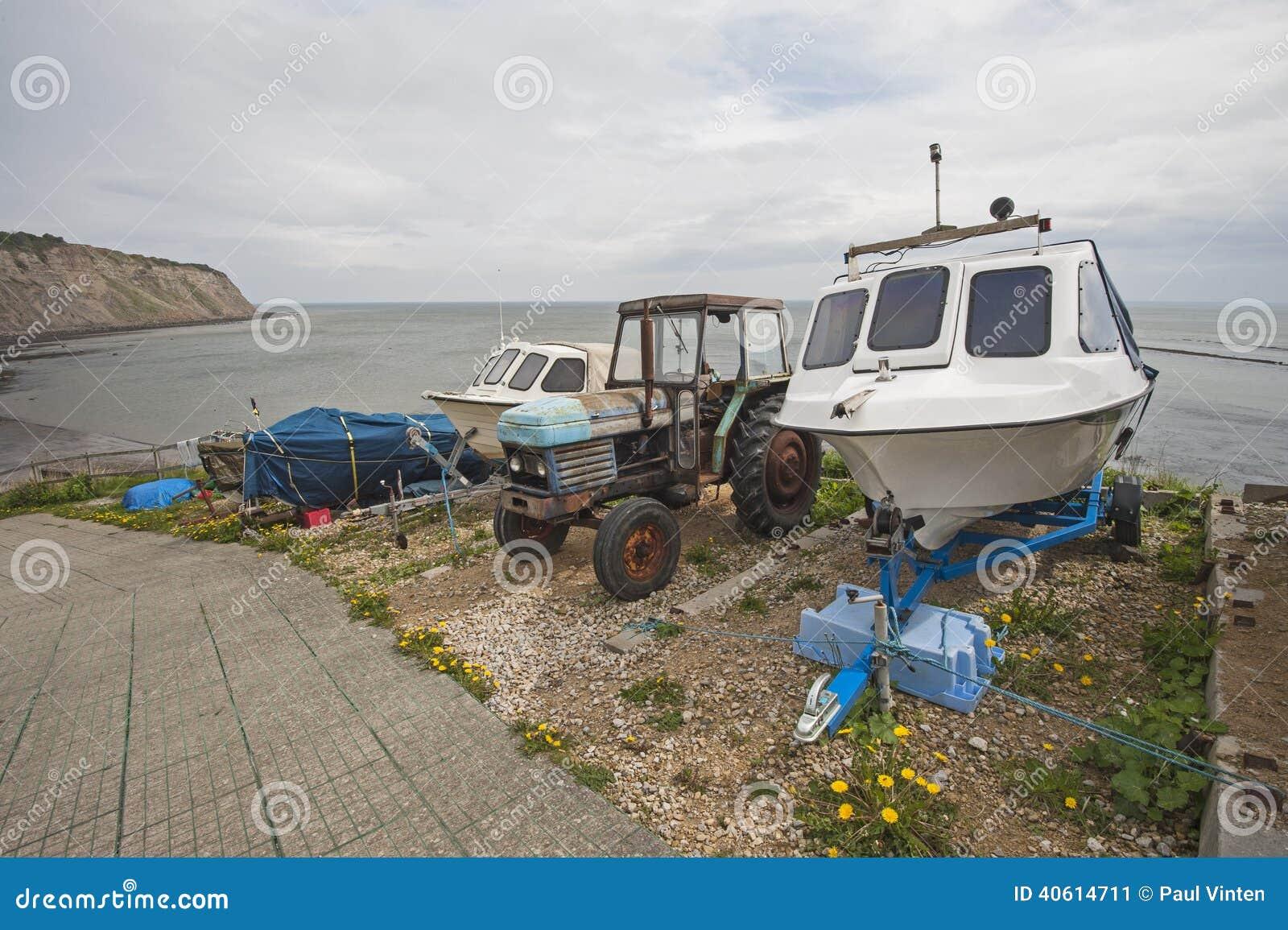 Small pleasure boat on slipway at coast