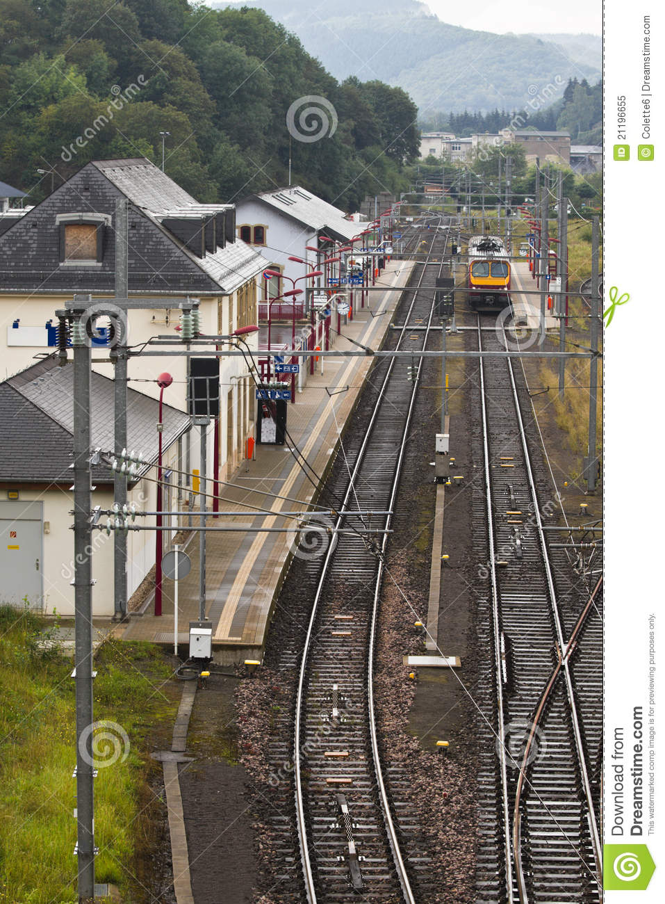 Small railwaystation with railroad and train