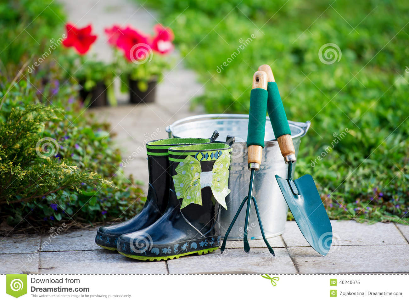 Small Rain Boots And Garden Tools Stock Photo - Image: 40240675