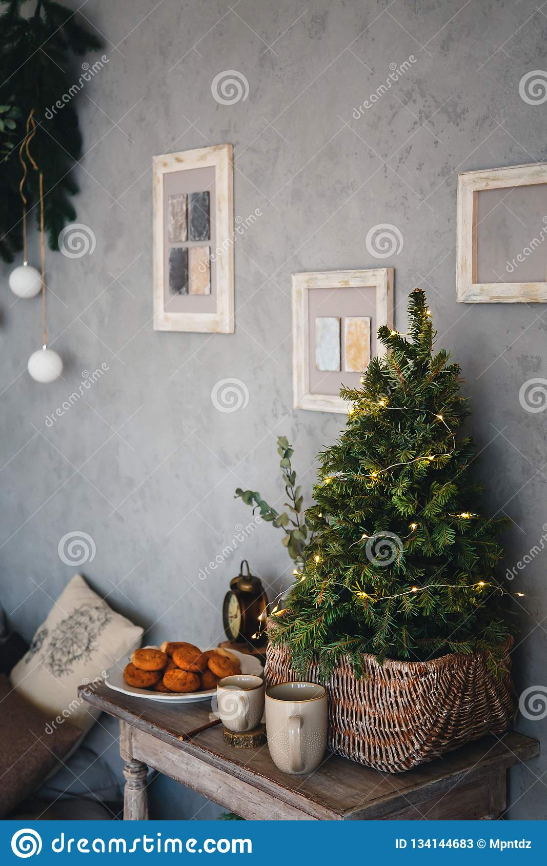 Small Real Christmas Tree With Yellow Christmas Lights Loft Style Modern Design Room In Light Colors Decorated For Stock Image Image Of Green Interior 134144683