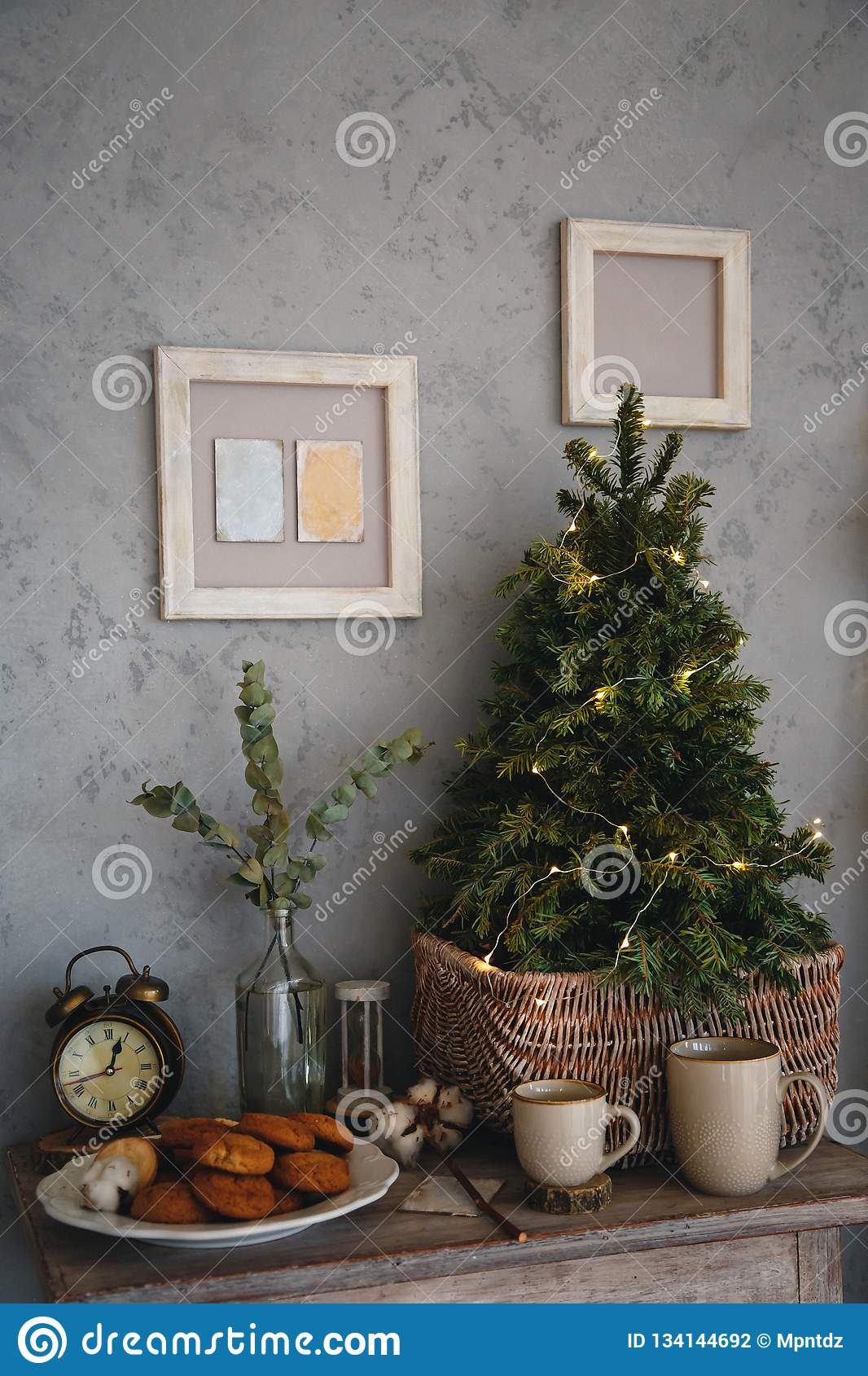 Small Real Christmas Tree With Yellow Christmas Lights Loft Style Modern Design Room In Light Colors Decorated For Stock Photo Image Of Cookies Decoration 134144692