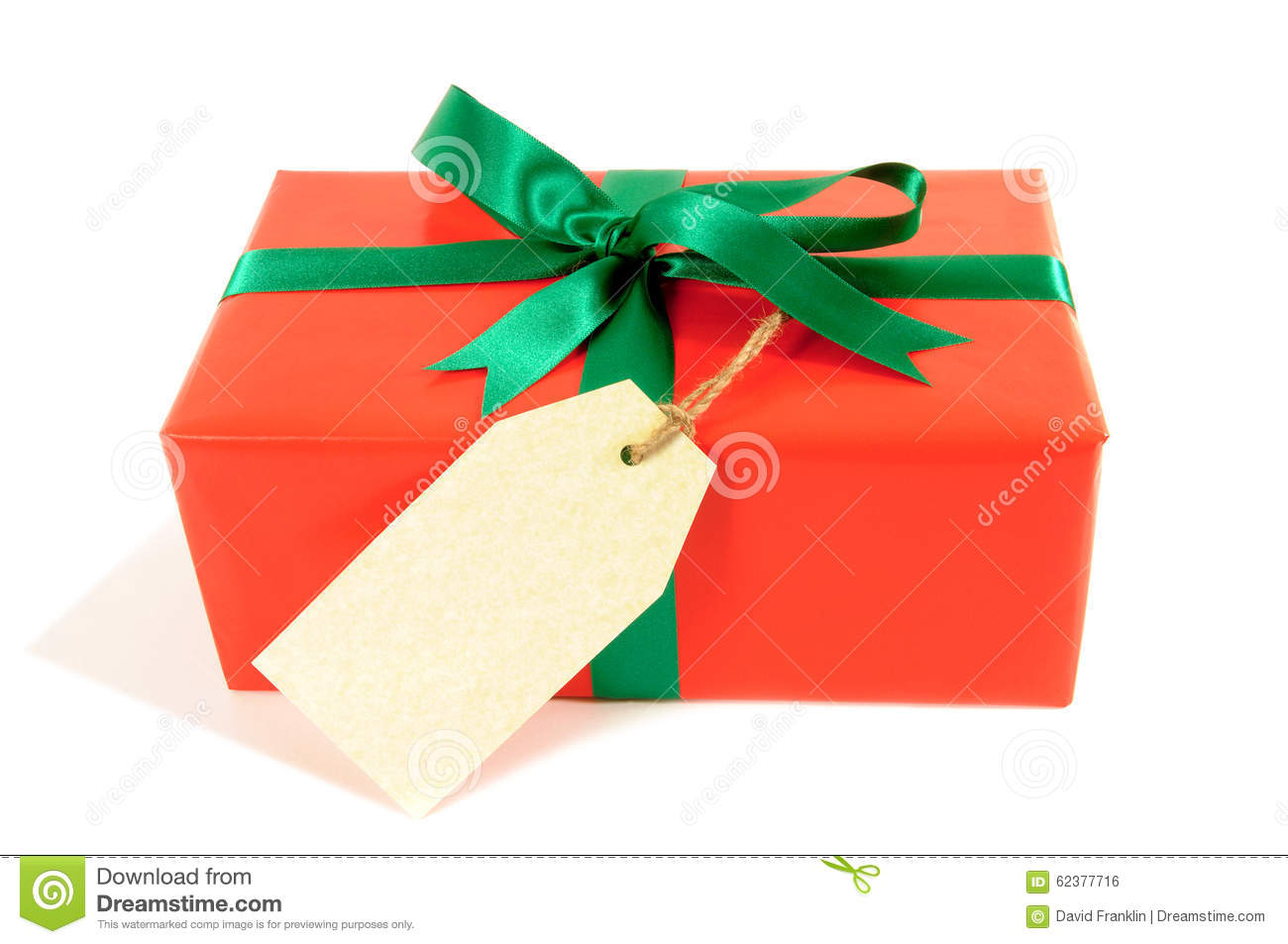 Small red christmas or birthday gift with green ribbon bow