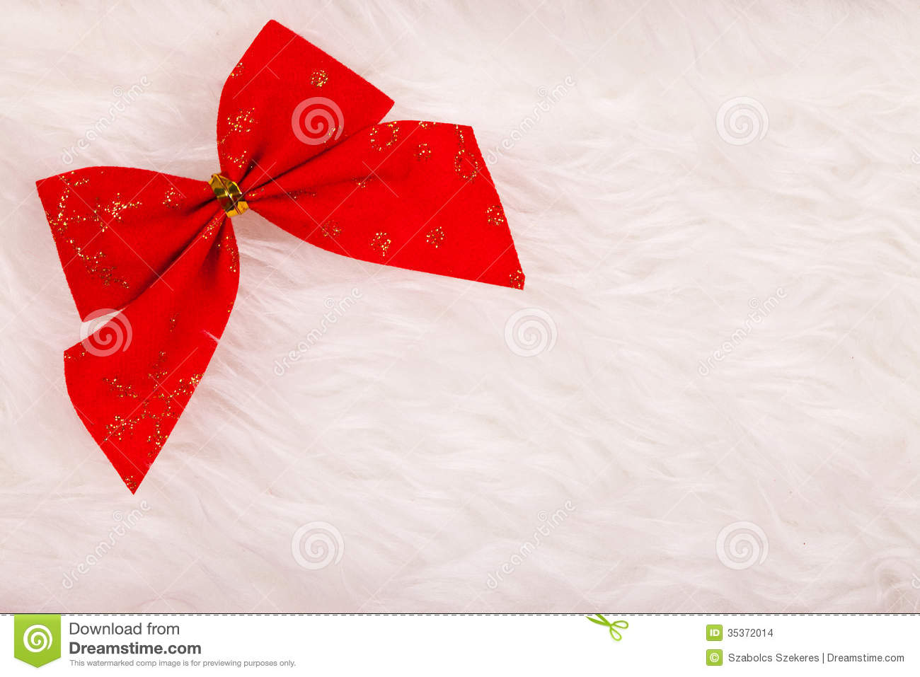 Small red christmas ribbon on fluffy background stock