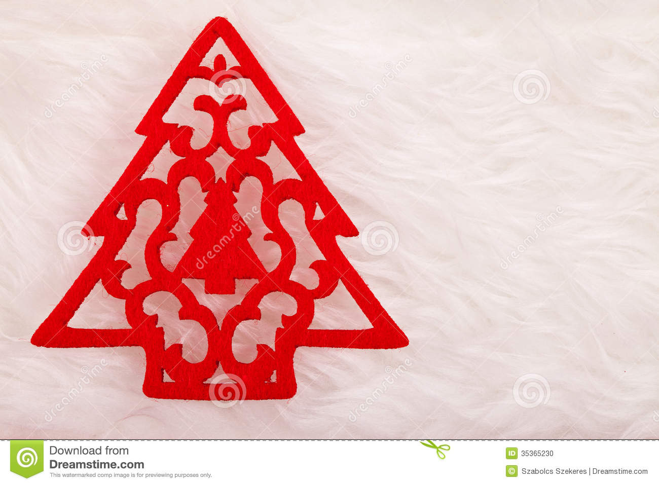 Small Red Christmas Tree On Fluffy Background Stock Photo
