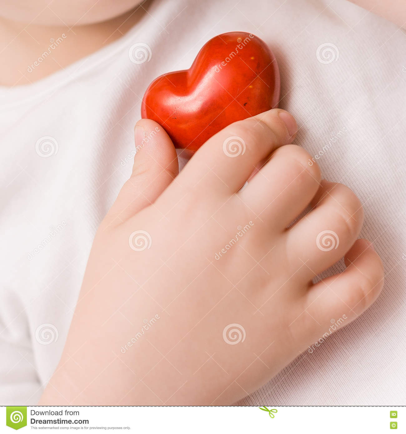 A Small Red Heart In Hand Of Child. Love. Happiness. Care ...
