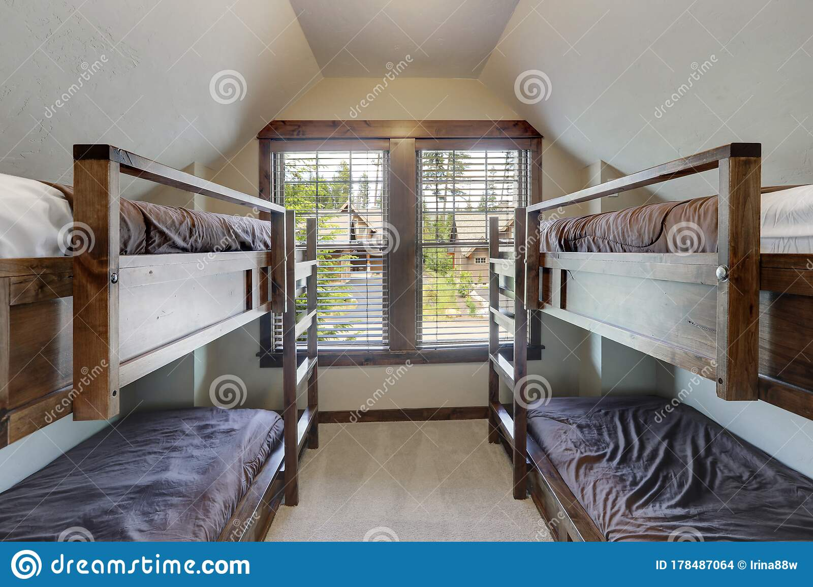 Picture of: Small Room With Vaulted Ceiling Above Garage With Four Bunk Beds For Kids Stock Photo Image Of Clean Designer 178487064