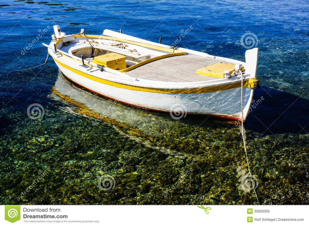 Small rowing boat is anchoring in clear water stock image for Shallow water fishing boats