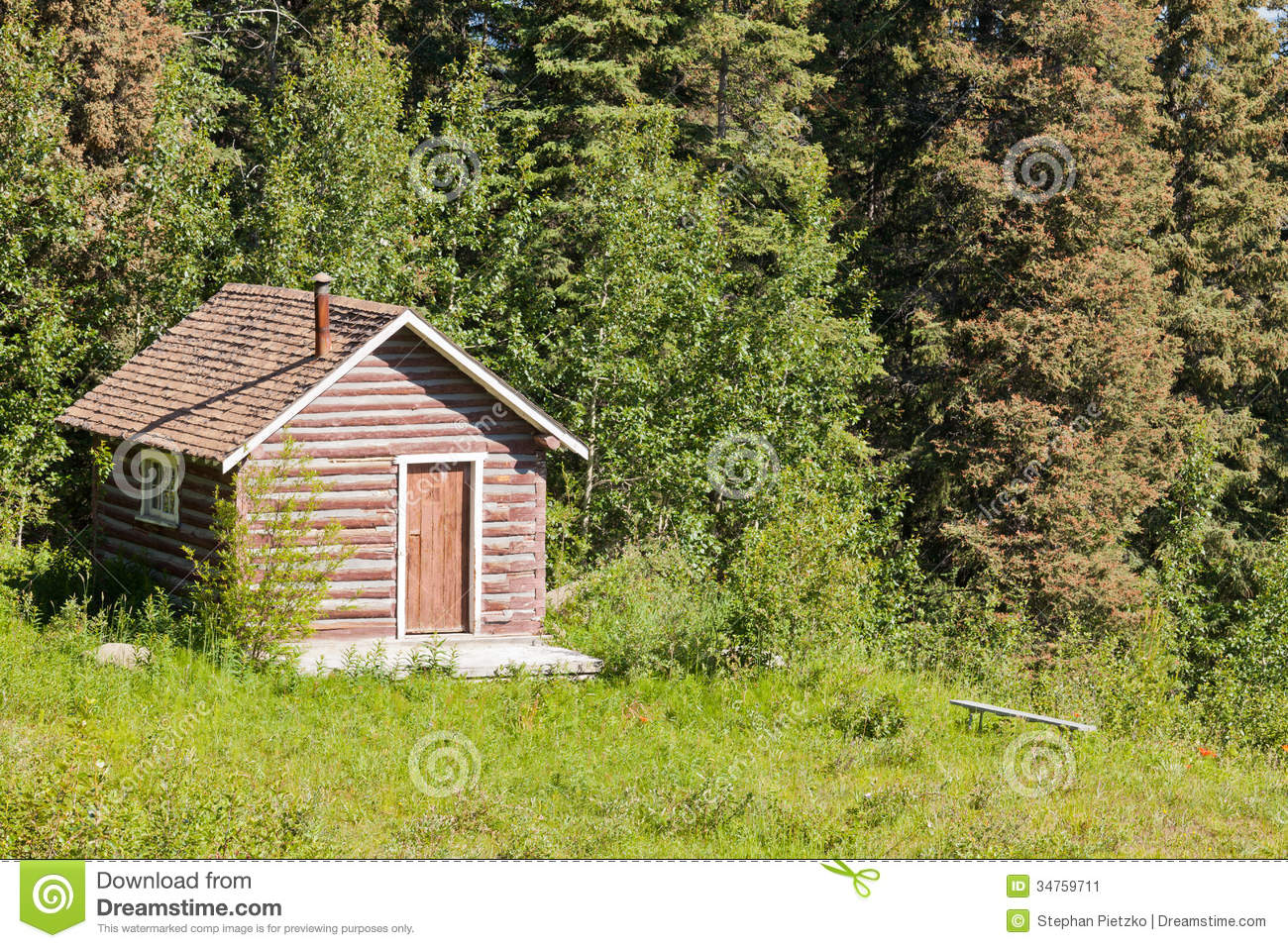 Small rural log cabin hut on clearing in forest stock for Small hut plans