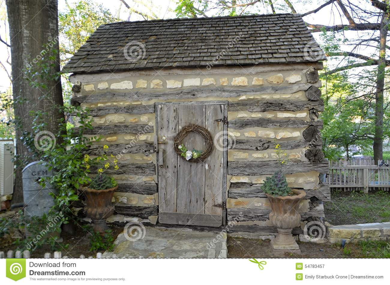 A Small Rustic Stone And Log Cabin In The Country Stock