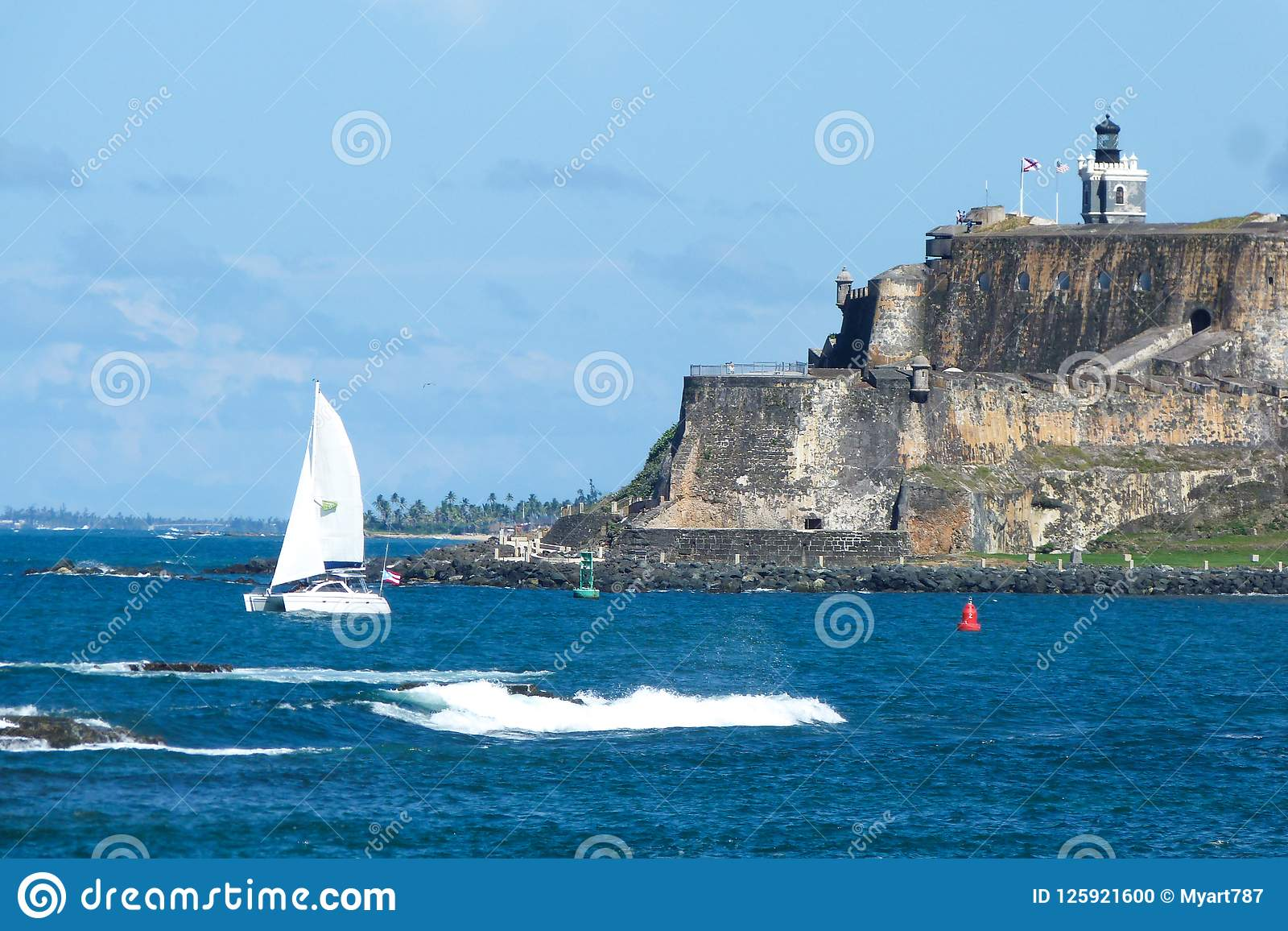 Sailboat in front of El Morro Castle