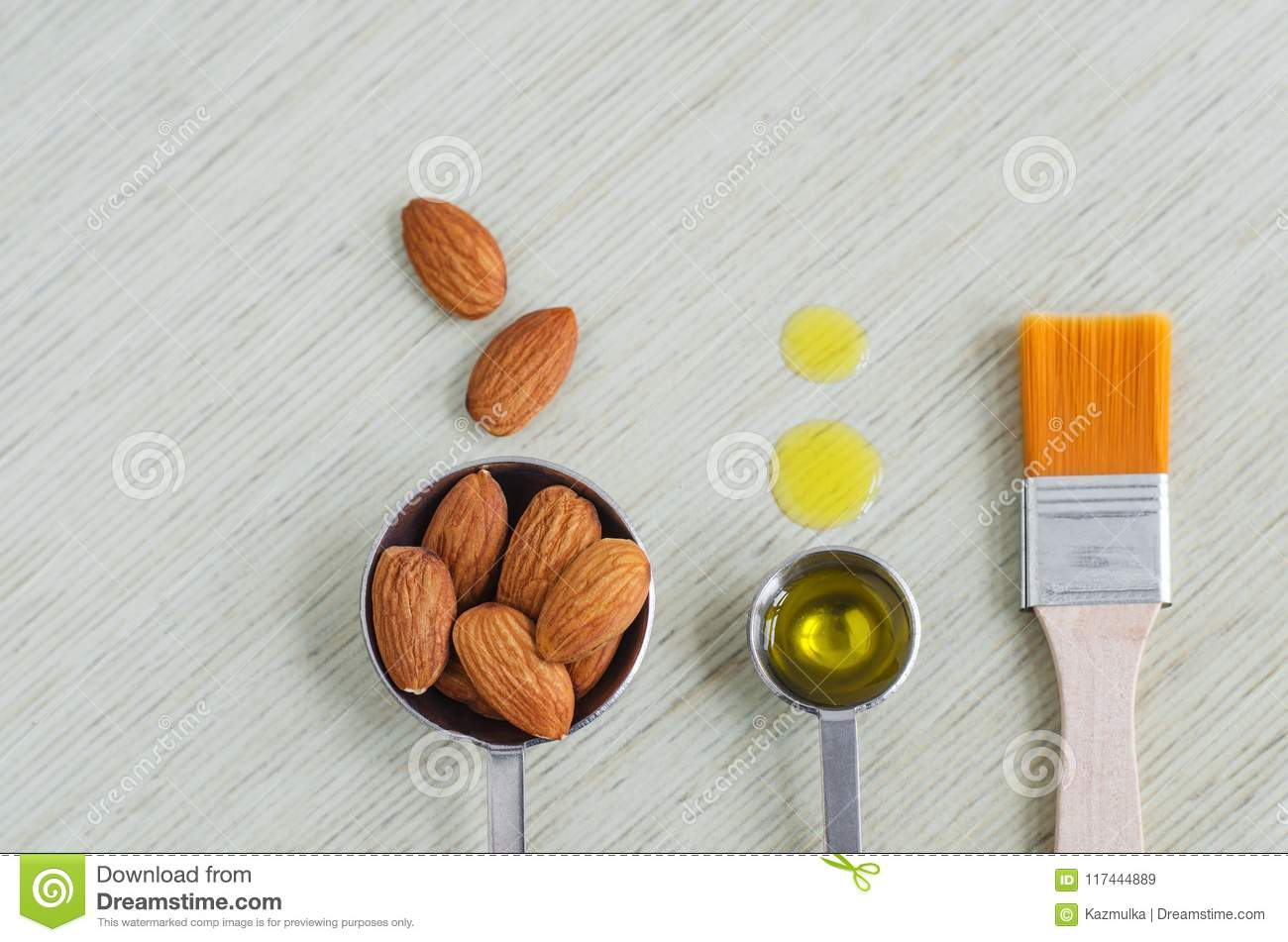 Small Scoops With Raw Almonds, Almond Oil And Cosmetic Brush