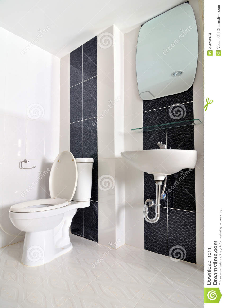 Small Simple Bathroom With Sink And Toilet Stock Photo