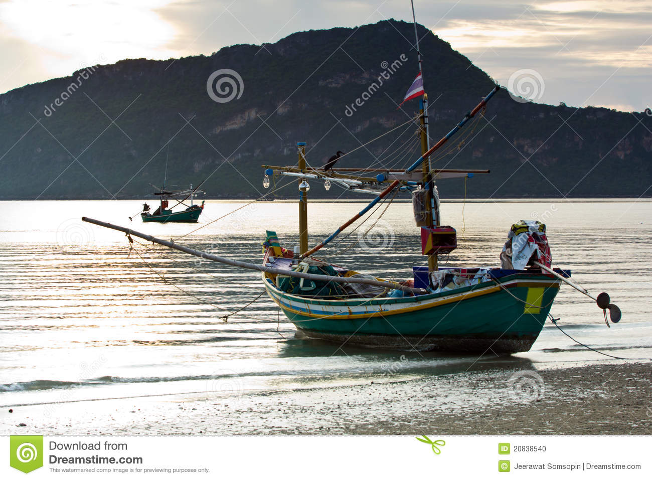 Small squid fishing boat at pranburi beach in the stock for How to not get seasick on a fishing boat