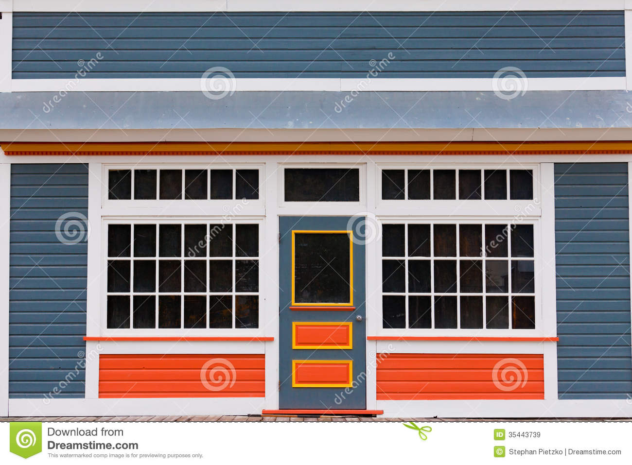 Symmetrical view of the front door and entrance to a quaint colorful ...