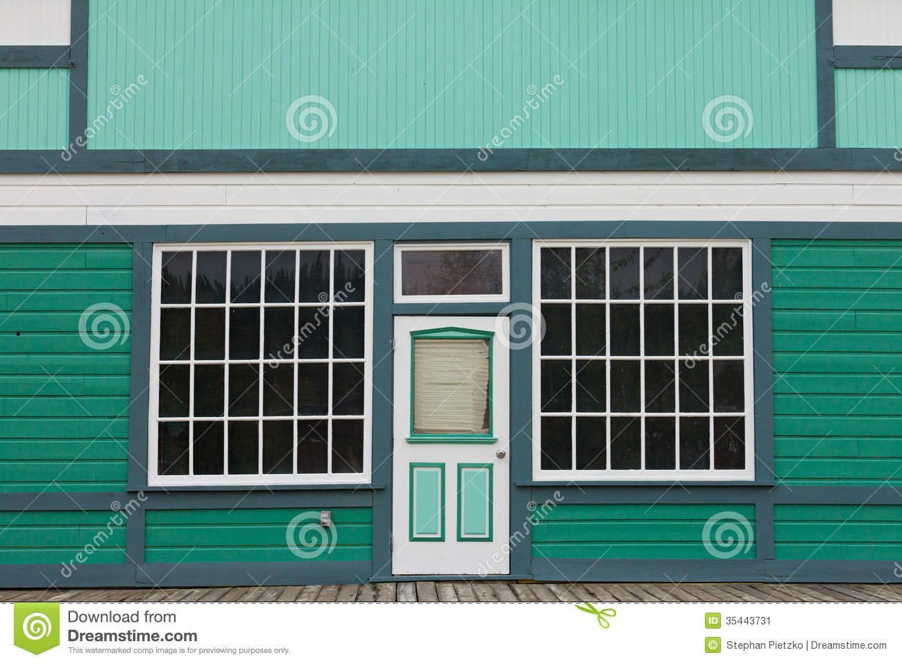 Small store front entrance to green wooden house stock for Window and door store