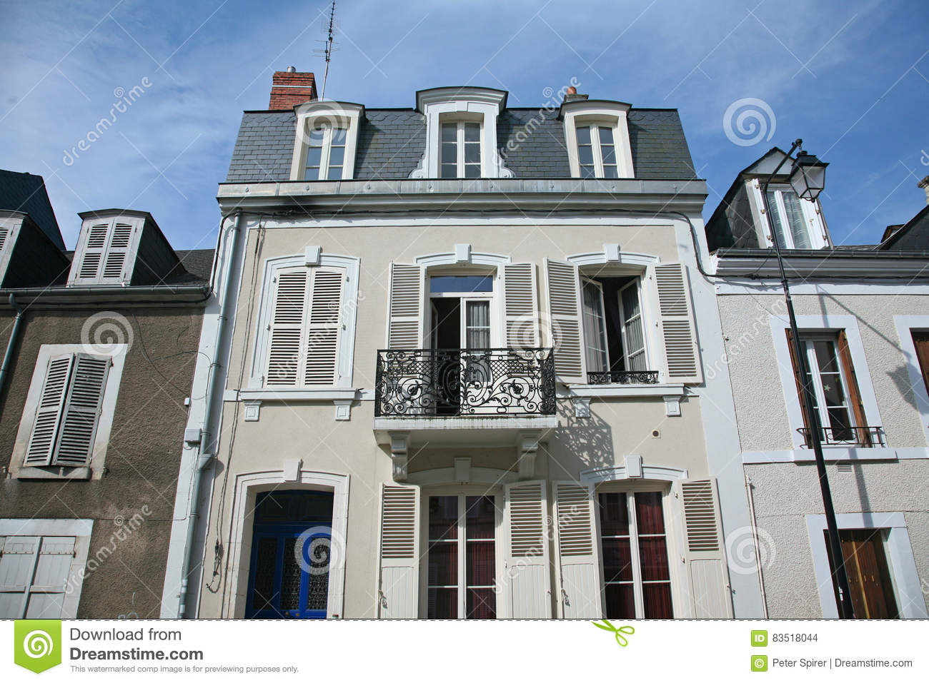 Small Town Apartment Building. French, Stucco.