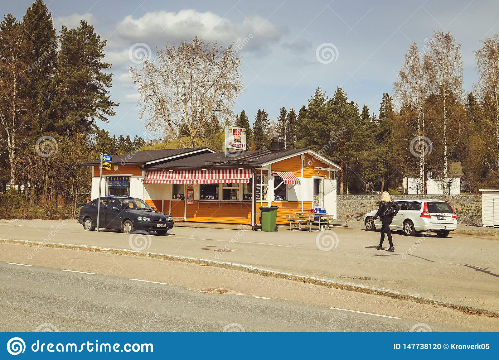 A small town in Finland, a roadside cafe, cars on the road and shops. Summer day of the Finnish town. coffee Jaffa