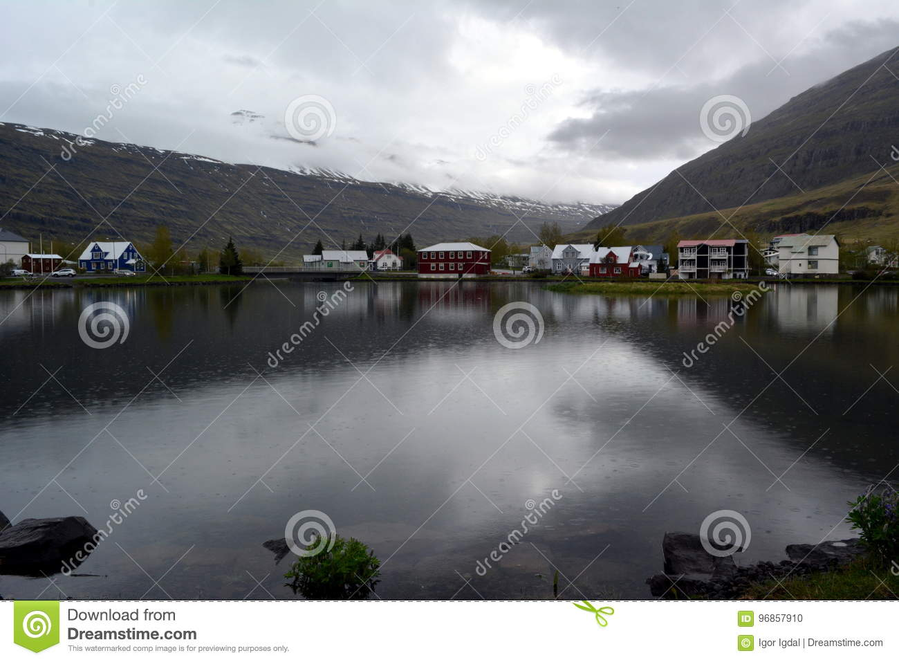 Small town of Seydisfjörður on the shore of the lake in the west of Iceland