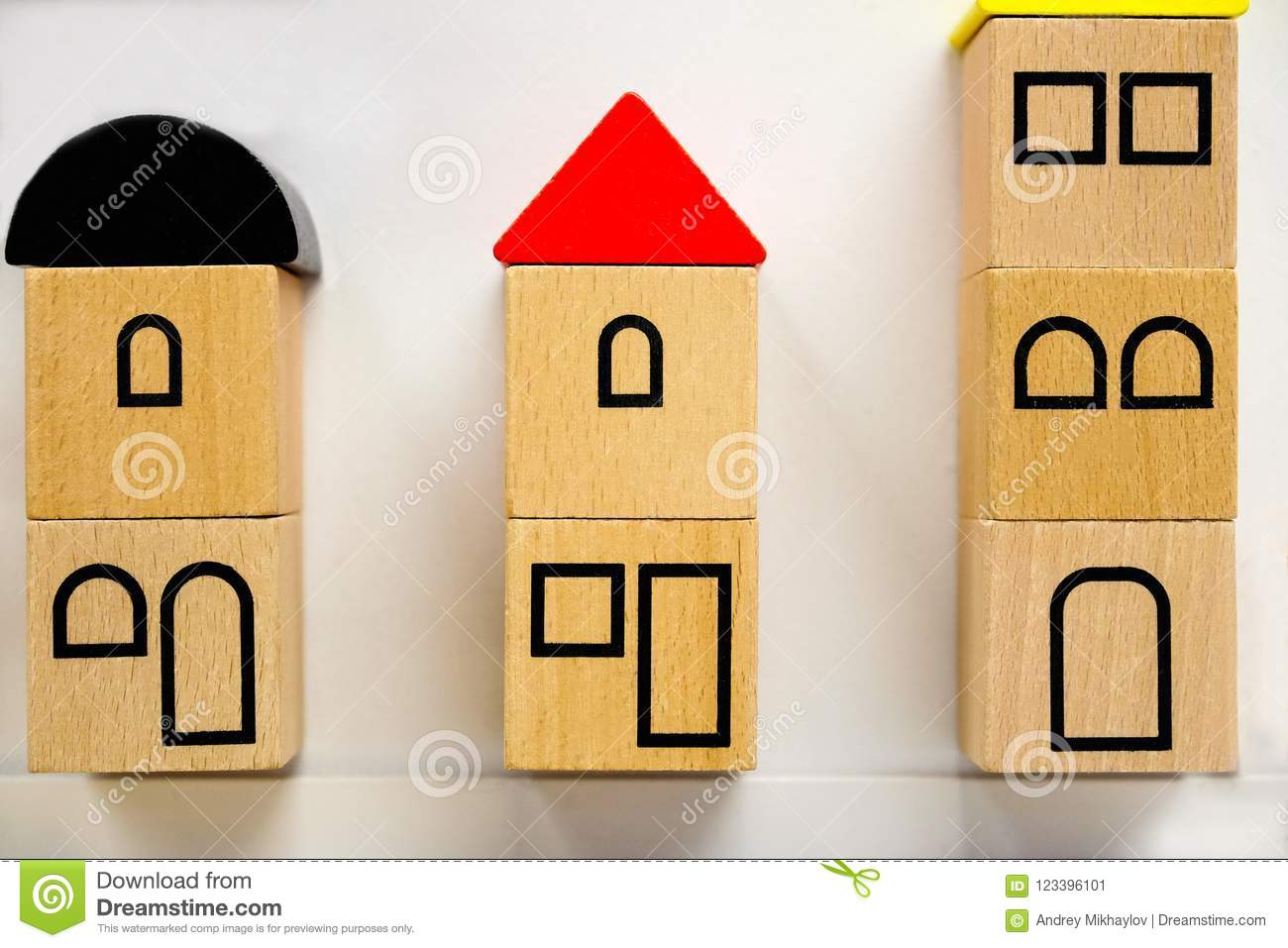 Small Toy Houses Made Of Wooden Blocks With Painted Windows Stock
