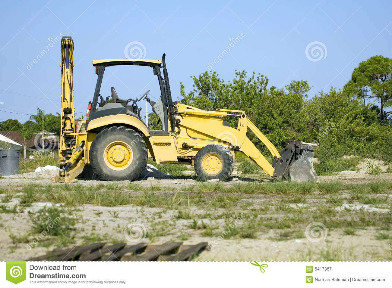 A Small Tractor With Backhoe And Blade Stock Image - Image of yellow
