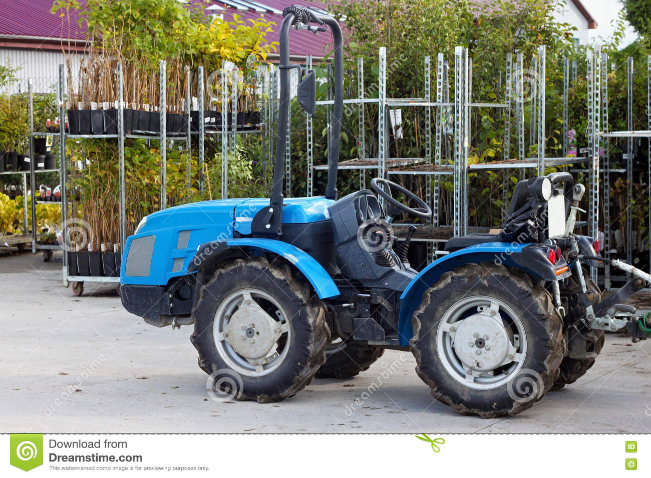 small tractor in the backyard stock photo image 78991177