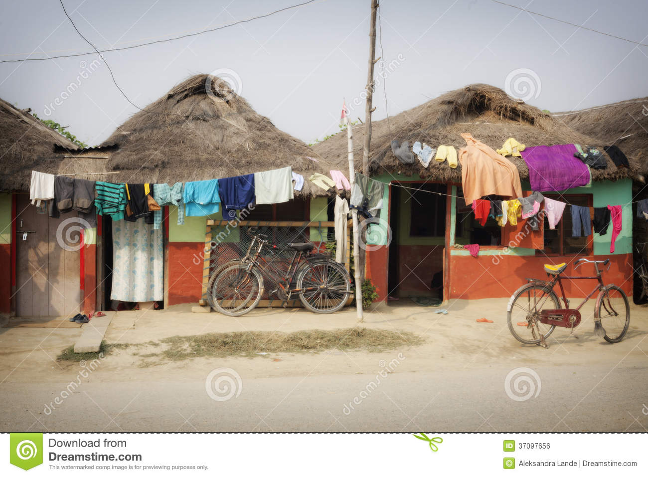 Small traditional clay houses of lumbini royalty free for Small house design in nepal