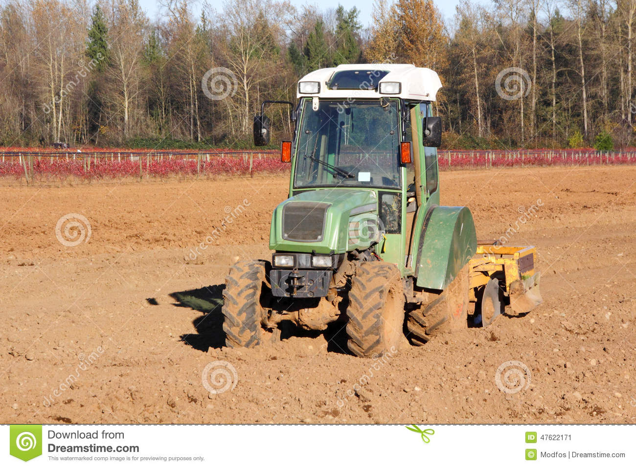 Small utility tractor and hobby farm stock photo image for Utility of soil