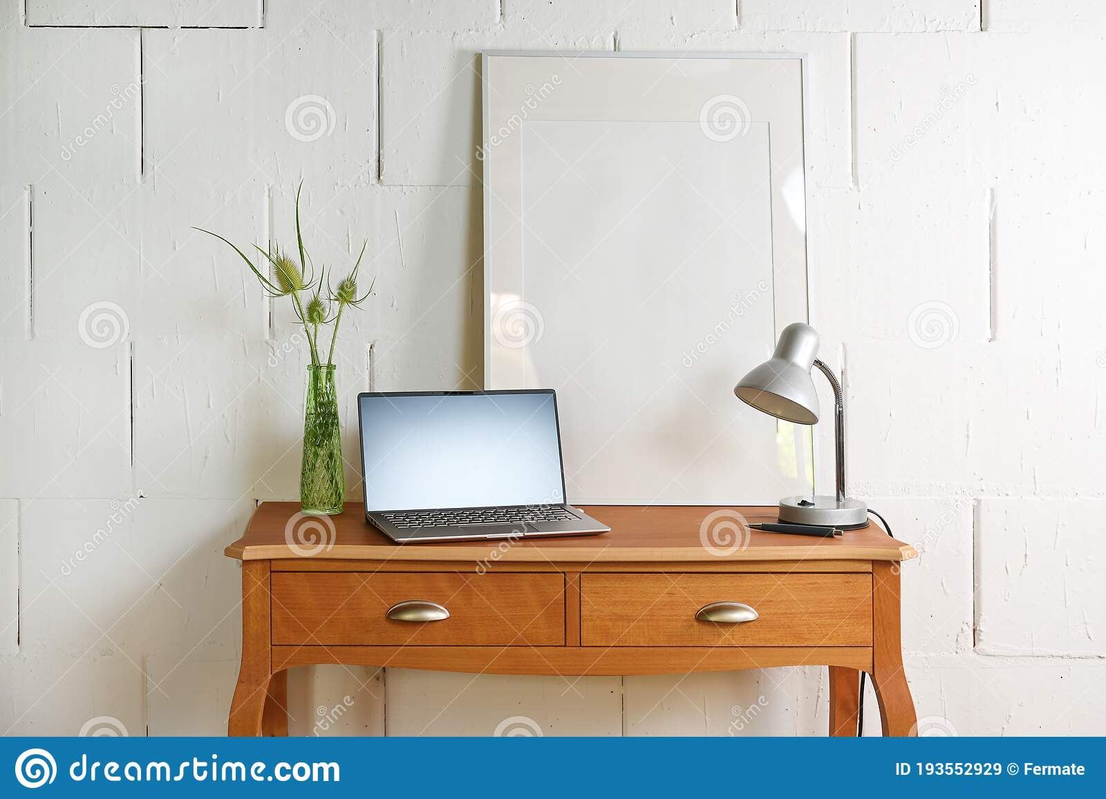 Small Vintage Table Of Reddish Wood With Laptop Desk Lamp And A Picture Frame In Front Of A Raw White Wall Tiny Home Office Stock Image Image Of Laptop Frame 193552929