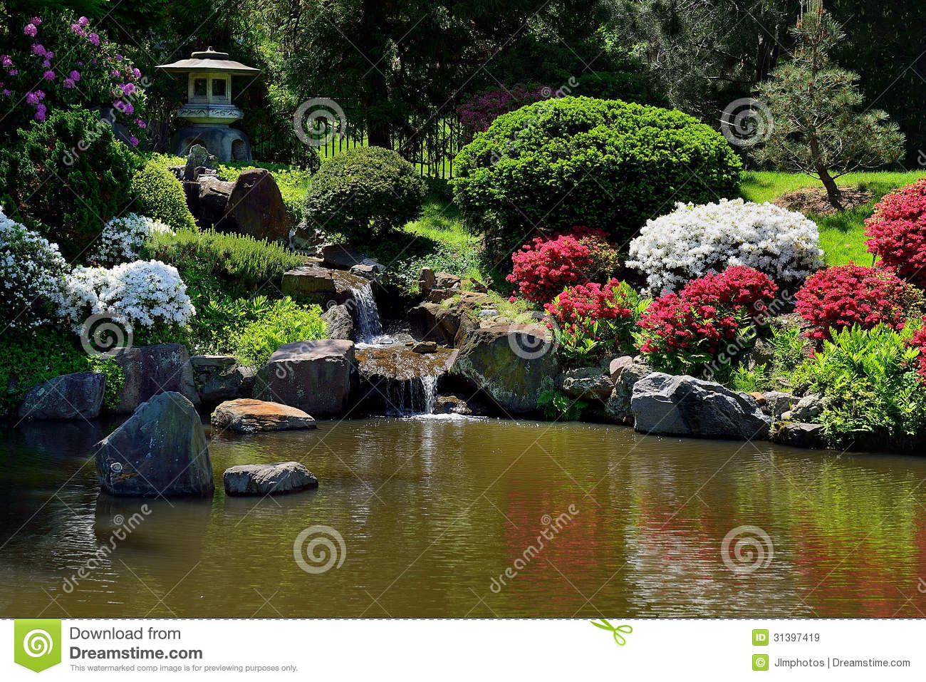 Small water fall fountain in asian japanese garden stock for Koi pond jets