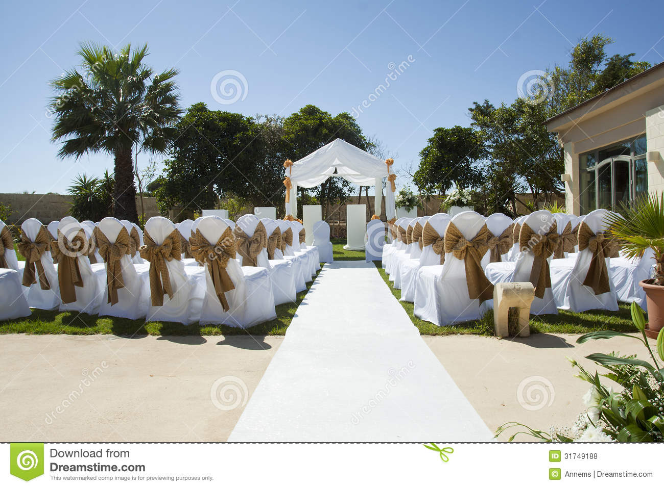 Small Wedding Tent In Garden With Chairs On Lawn Royalty