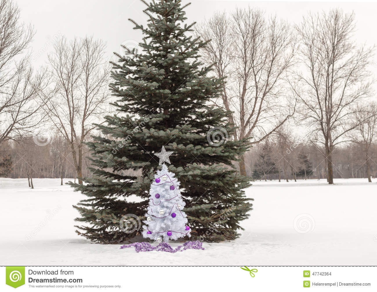 Christmas tree decorations purple and silver - Small White Christmas Tree With Purple And Silver Decorations Standing In Snow Stock Photo