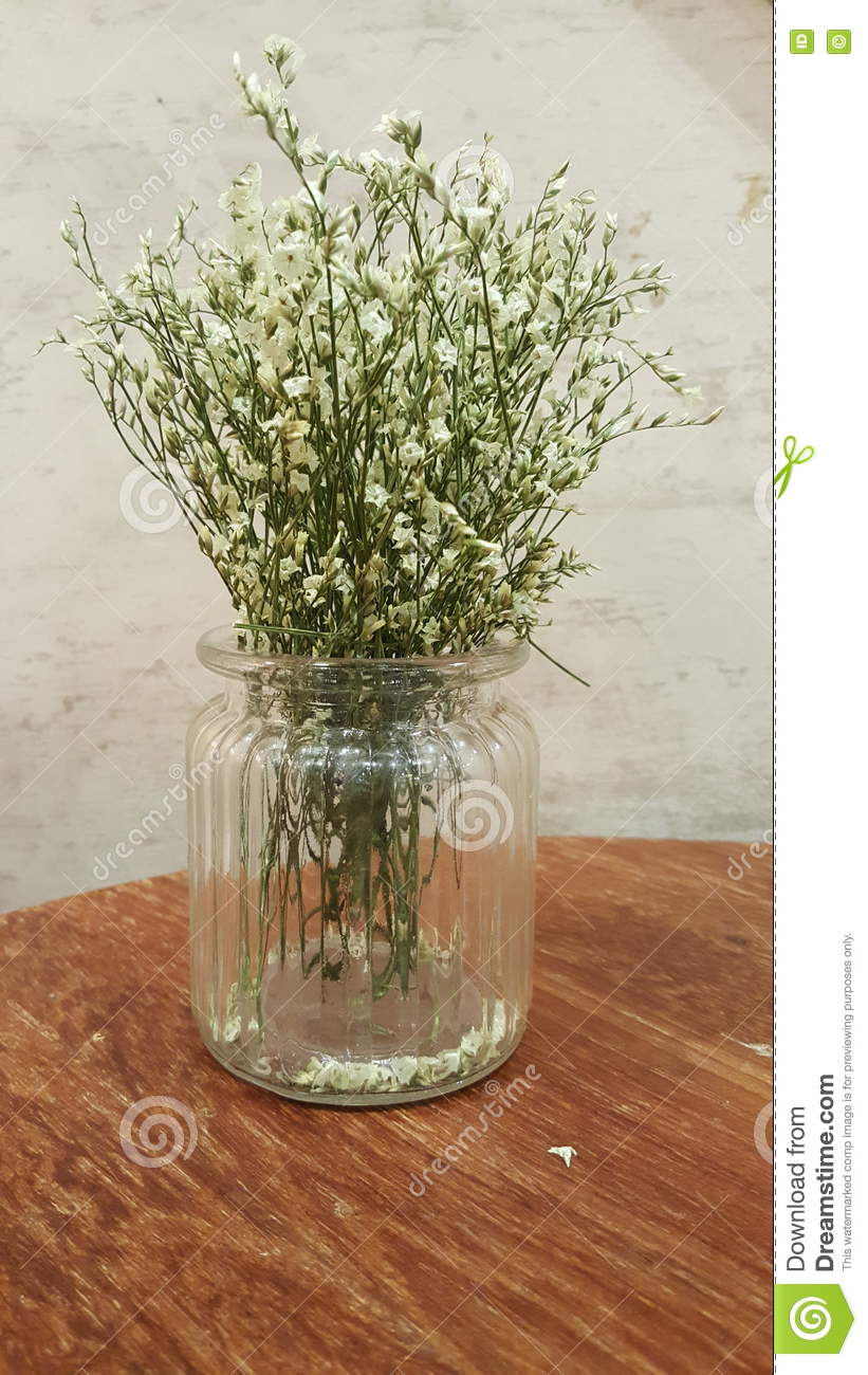 Small White Flowers In Clear Glass Vase On Wood Table Stock Image ...