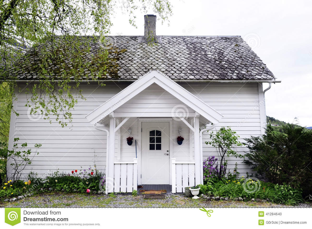 small wooden white house with front porch nordic stock