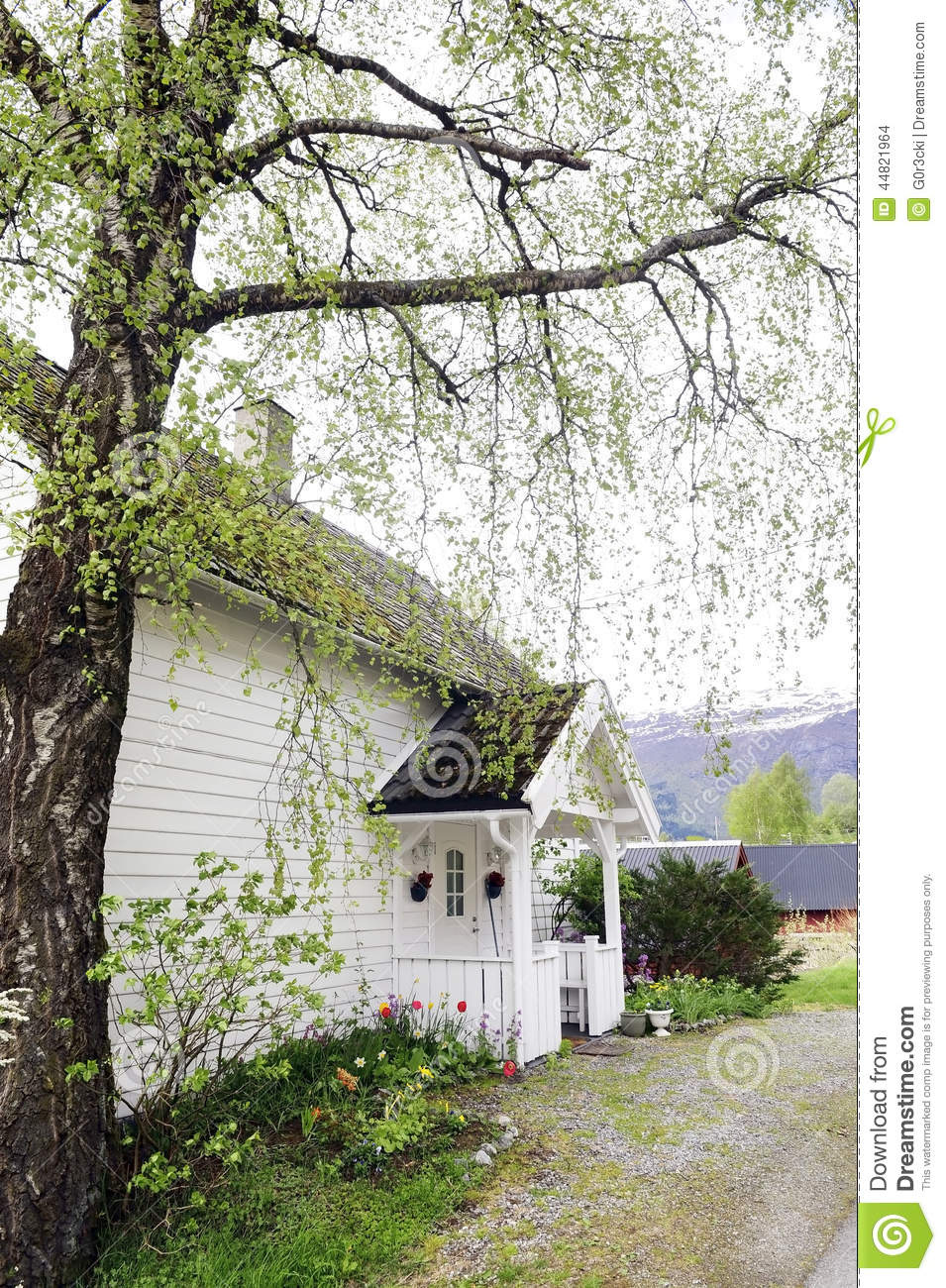 Small White House With Front Wood Porch Stock Photo