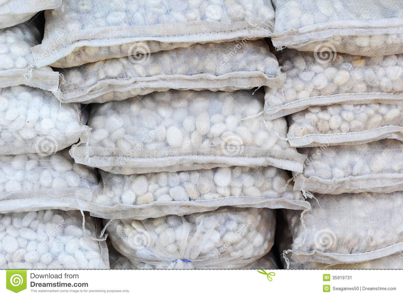 small white stones in a bag for landscaping stock image