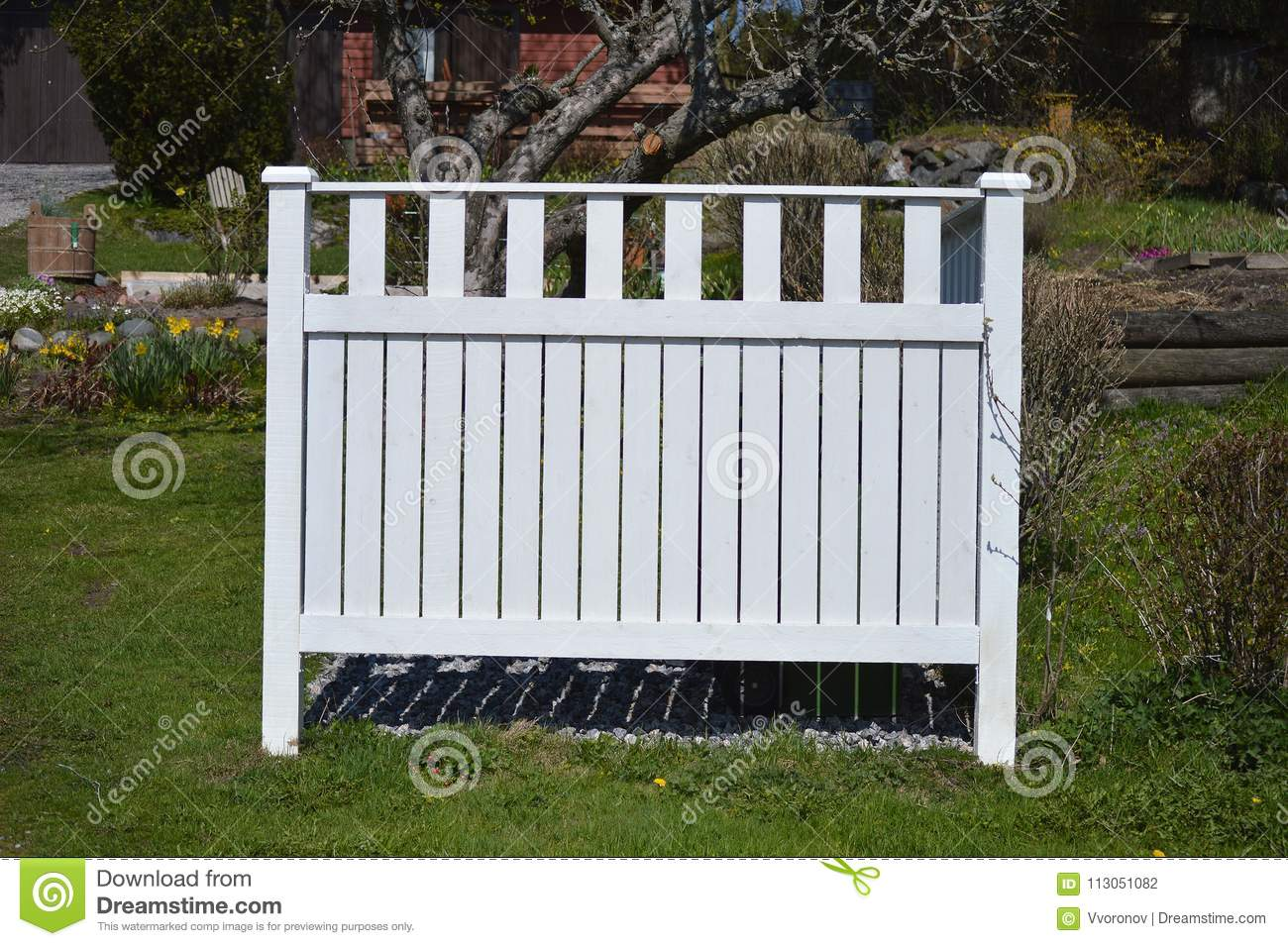 Small White Wooden Fence In The Garden