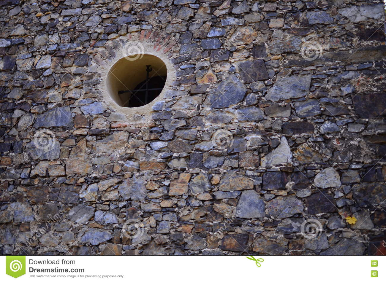 Small Round Windows: Small Window In The Stone Wall Stock Photo
