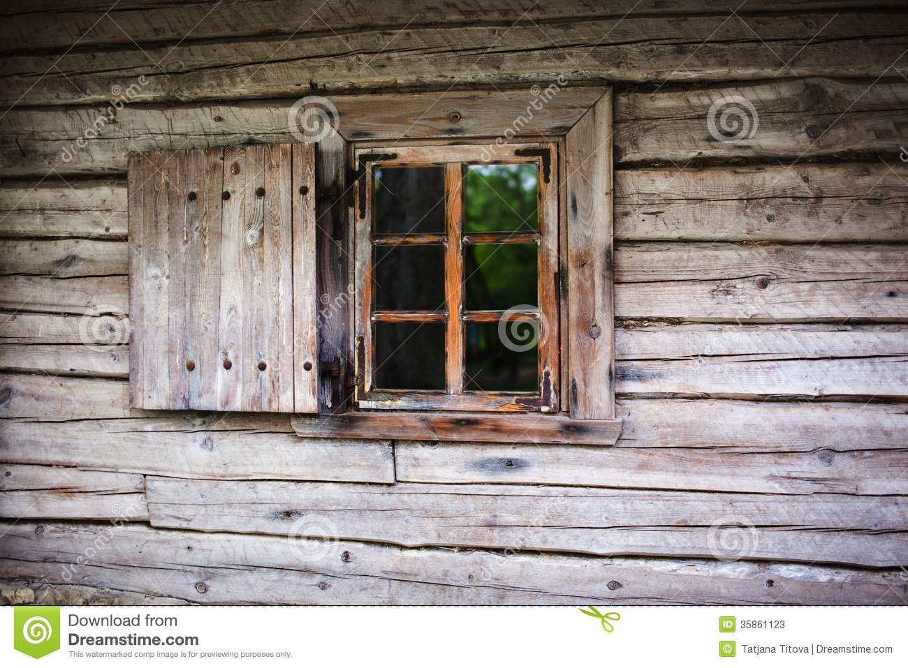 Small window in the wall of an old wooden house stock for Wood house images