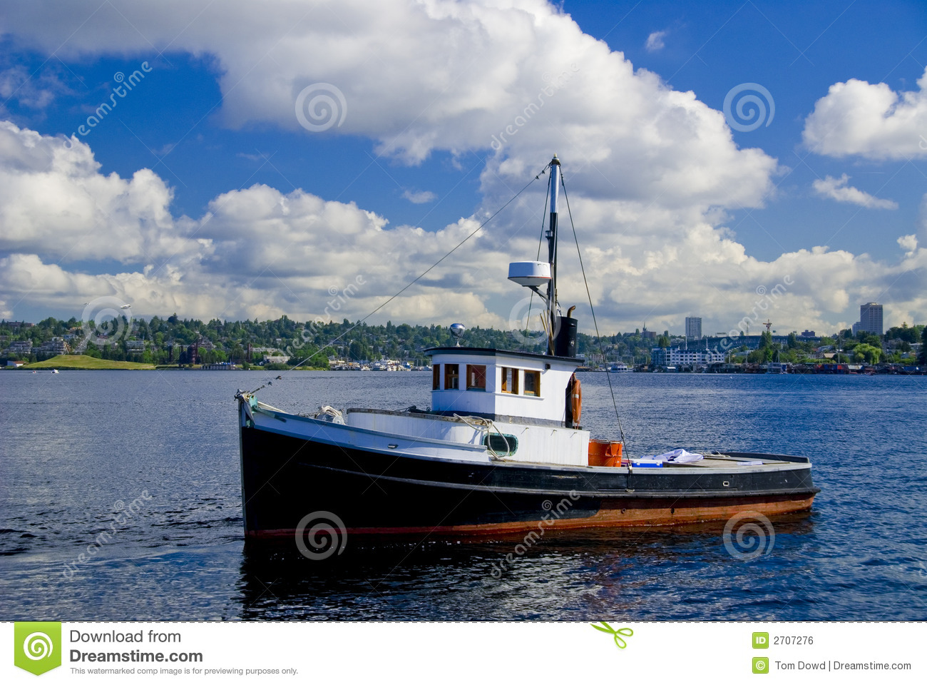 small wooden fishing boat on Lake Union in Seattle, WA.