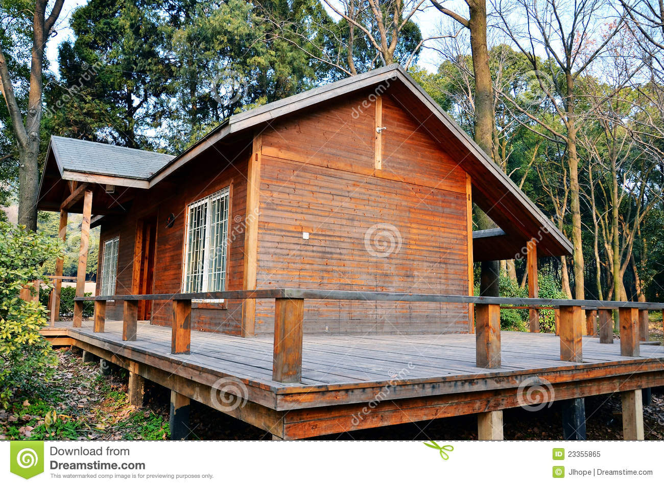 Small wood house royalty free stock photo image 23355865 for Simple modern wood house