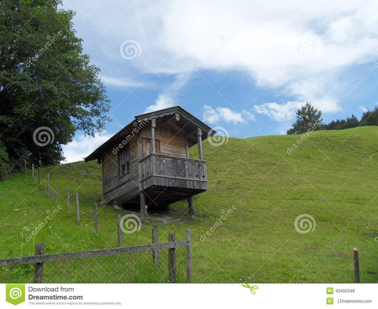 Small Wooden Alpine Style House On The Hill Stock Photo