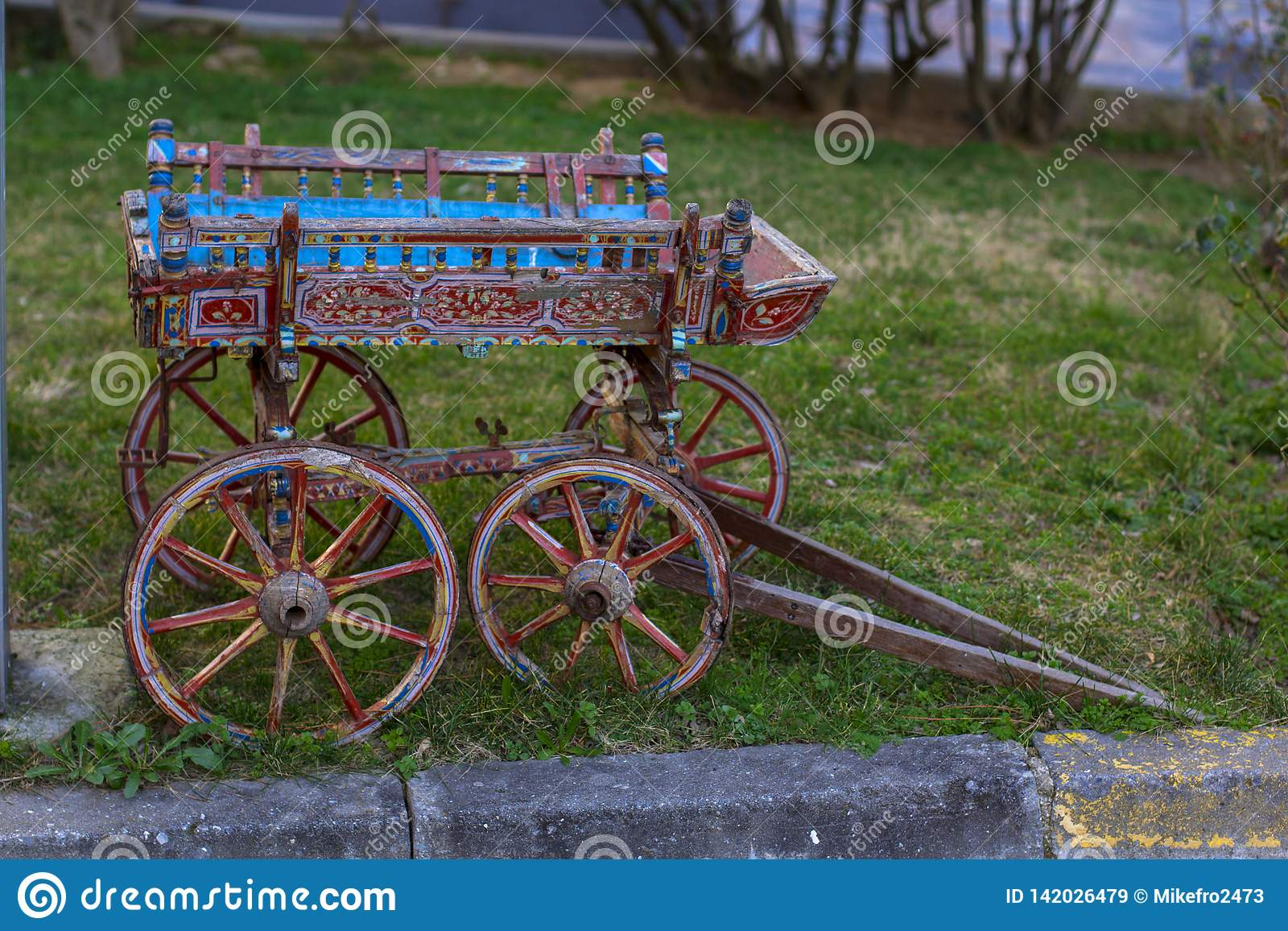 Small wooden cart on a meadow in the village