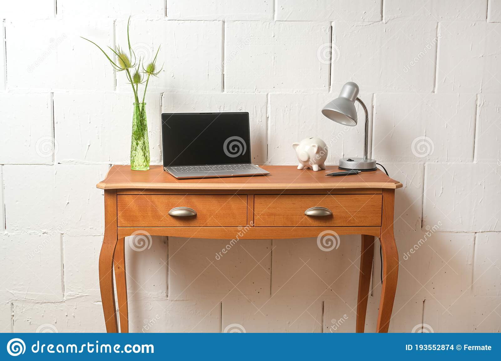 Small Wooden Console Table With Laptop Desk Lamp And A Piggy Bank As A Place For A Tiny Home Office Against A Bare White Wall Stock Photo Image Of Laptop Decoration
