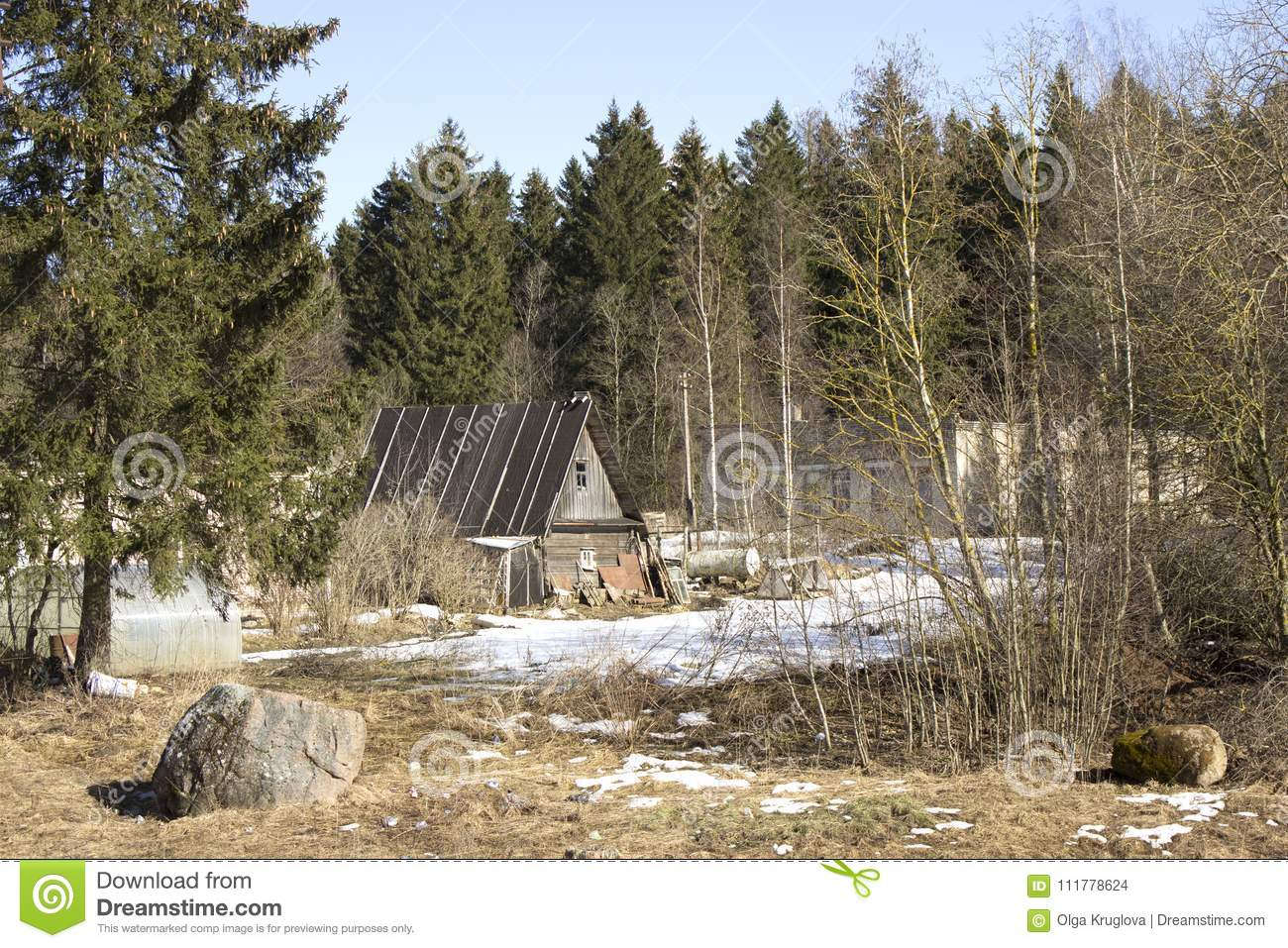 A small wooden house at the edge of a forest